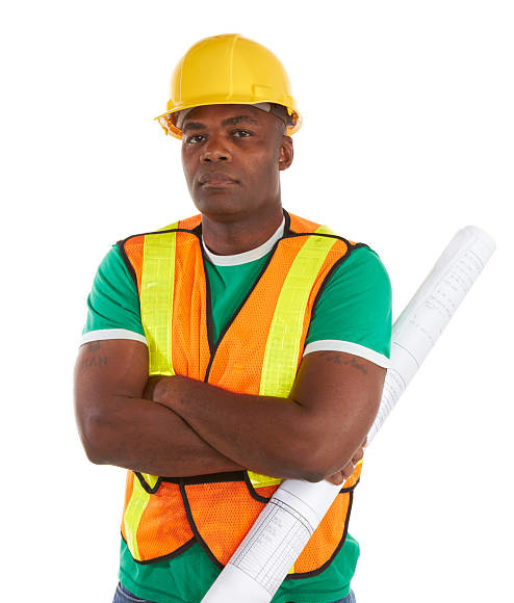 serious african american construction worker with arms crossed holding blueprints.http://i1100.photobucket.com/albums/g409/matthewennisphotography/Constructionbanner1.jpg